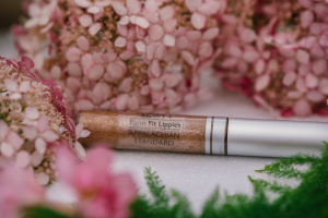 A close up of Serenity and Scott Lipgloss in Appalachian Standard's Provisions line at the greenhouse.